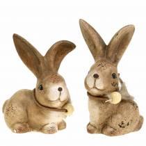 Figure decorative conigli con piuma e legno marrone perla assortiti 7 cm x 4,9 cm H 10 cm 2 pezzi
