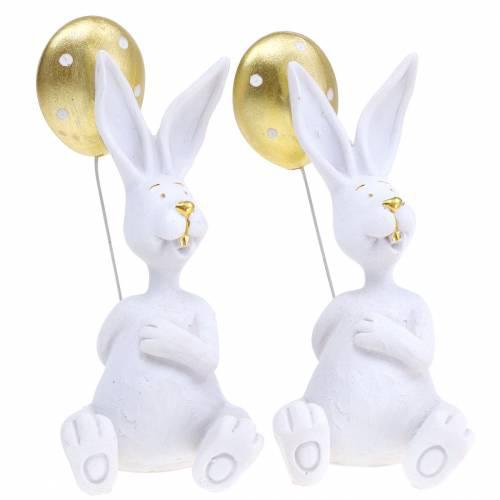 Coniglio con palloncino seduto bianco, oro H13,5 cm 2 pezzi